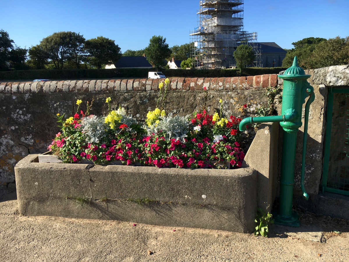 Abreuvoir in Torteval now used as a flower trough